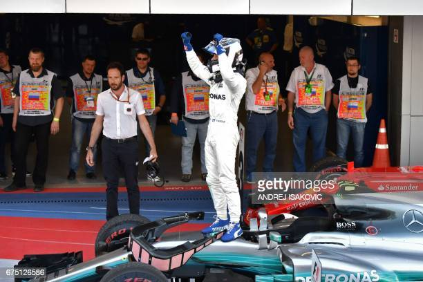 Mercedes' Finnish driver Valtteri Bottas celebrates with the team's crew after winning the Formula One Russian Grand Prix at the Sochi Autodrom...