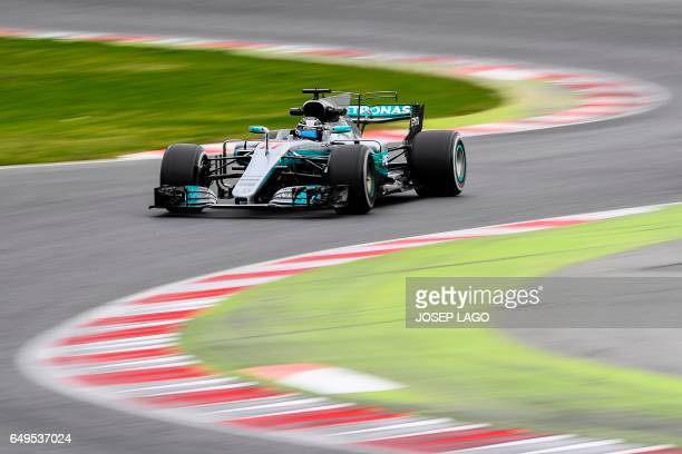 TOPSHOT Mercedes' Finnish driver Valtteri Bottas drives at the Circuit de Barcelona Catalunya on March 8 2017 in Montmelo on the outskirts of...