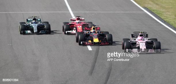 Mercedes' Finnish driver Valtteri Bottas Ferrari's German driver Sebastian Vettel Red Bull's Australian driver Daniel Ricciardo and Force India's...