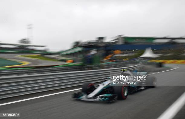 Mercedes' Finnish driver Valtteri Bottas powers his car during the Brazilian Formula One Grand Prix qualifying session at the Interlagos circuit in...