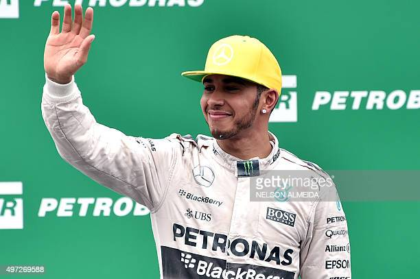 Mercedes' Formula One British driver Lewis Hamilton celebrates after getting the second place at the Brazilian Grand Prix at the Interlagos racetrack...