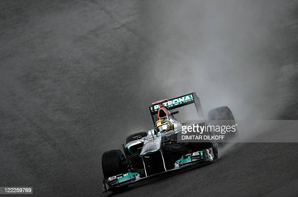 Mercedes' German driver Michael Schumacher drives at the SpaFrancorchamps circuit on August 27 2011 in Spa during the third practice session of the...