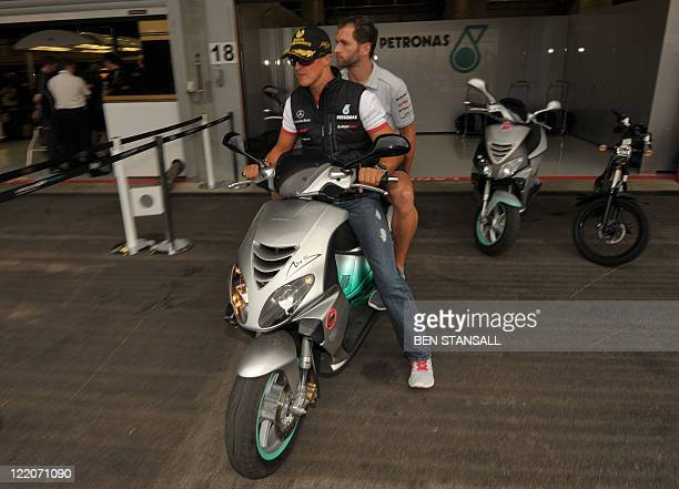 Mercedes' German driver Michael Schumacher leaves the pits on August 25 2011 in Spa ahead of the Belgium Formula One Grand Prix AFP PHOTO / BEN...