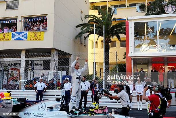 Mercedes' German driver Nico Rosberg celebrates winning at the Circuit de Monaco in Monte Carlo on May 26 2013 after the Monaco Formula One Grand...