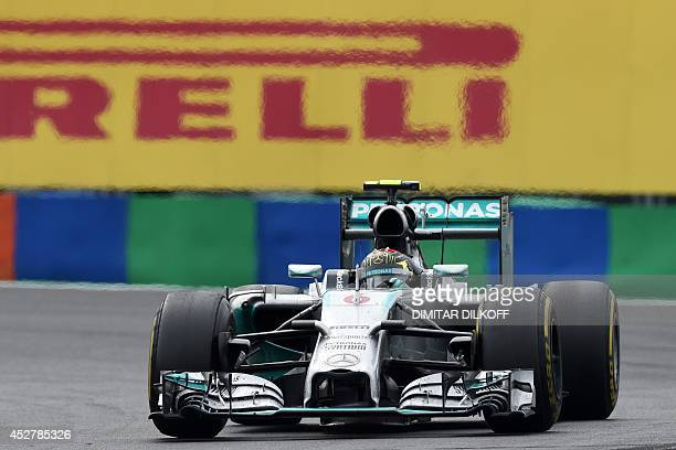 Mercedes' German driver Nico Rosberg drives during the Hungarian Formula One Grand Prix at the Hungaroring circuit in Budapest on July 27 2014 Red...