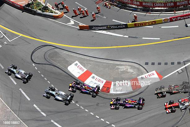 Mercedes' German driver Nico Rosberg leads after the start of the Monaco Formula One Grand Prix at the Circuit de Monaco in Monte Carlo on May 26...