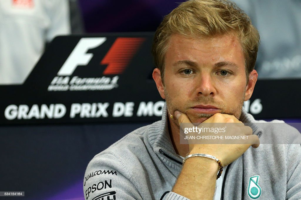 Mercedes' German driver Nico Rosberg looks on during a press conference at the Monaco street circuit in Monte-Carlo on May 25, 2016, four days ahead of the Monaco Formula One Grand Prix. / AFP / Jean-Christophe MAGNENET