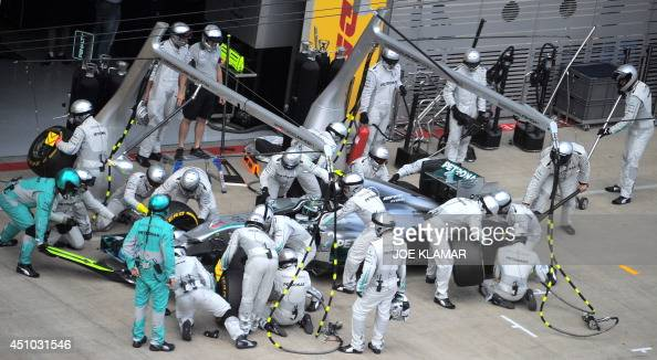 Mercedes' German driver Nico Rosberg makes a pit stop as he competes in the Austrian Formula One Grand Prix at the Red Bull Ring in Spielberg on June...
