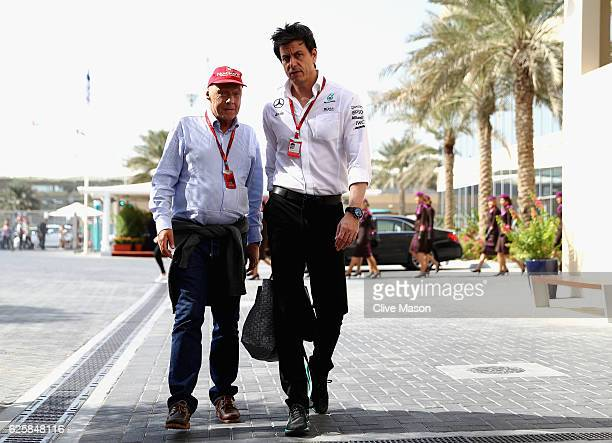Mercedes GP Executive Director Toto Wolff and Mercedes GP nonexecutive chairman Niki Lauda walk in the Paddock before final practice for the Abu...