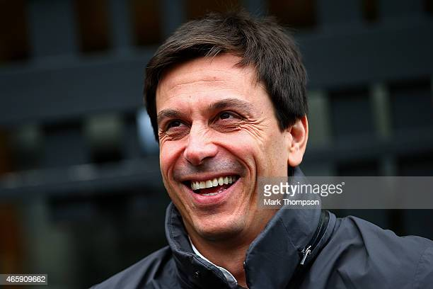 Mercedes GP Executive Director Toto Wolff smiles as he speaks with members of the media next to St Kilda beach during previews to the Australian...