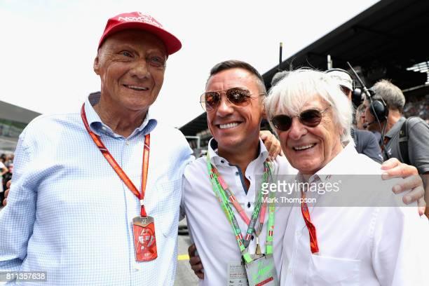 Mercedes GP nonexecutive chairman Niki Lauda poses for a photo with jockey Frankie Dettori and Bernie Ecclestone Chairman Emeritus of the Formula One...