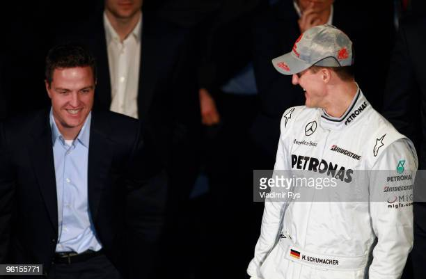 Mercedes GP Petronas Michael Schumacher speaks with his brother and former Formula One driver Ralf Schumacher during the Mercedes GP Petronas Formula...