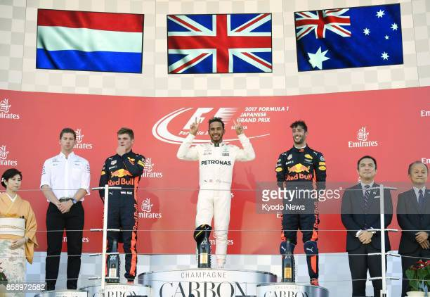 Mercedes' Lewis Hamilton celebrates winning the Formula One Japanese Grand Prix at the Suzuka circuit in Mie Prefecture on Oct 8 2017 Alongside...