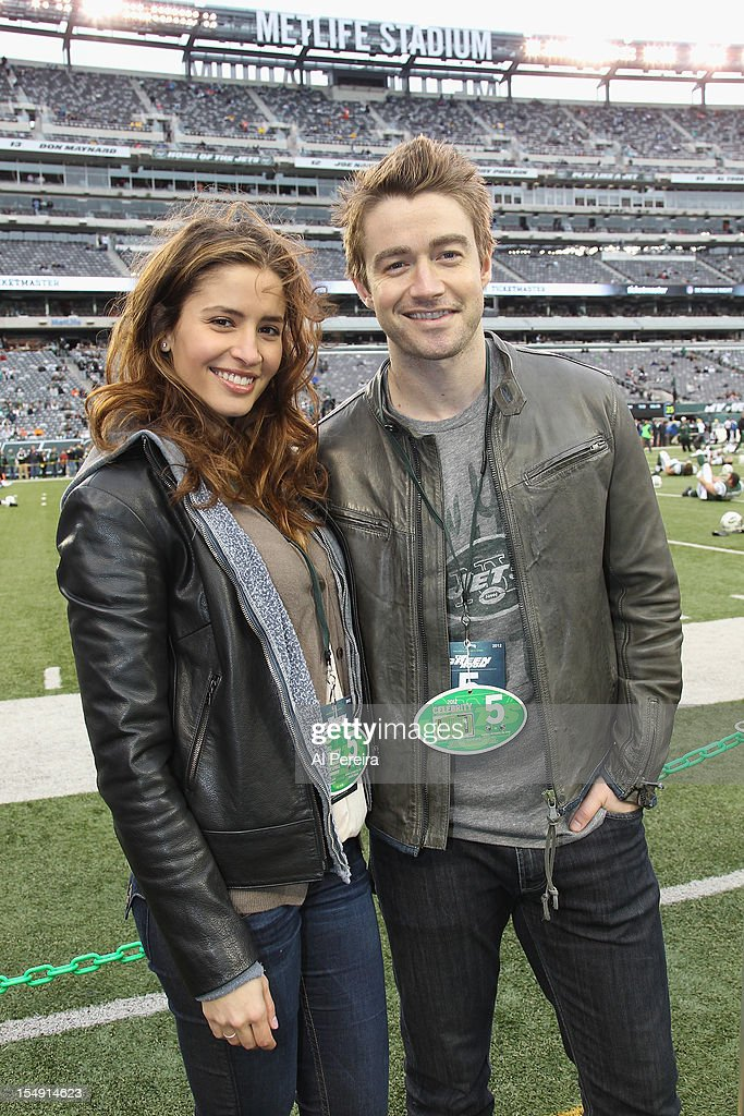 Mercedes Masohn and Robert Buckley attend the Miami Dolphins vs New York Jets game at MetLife Stadium on October 28 2012 in East Rutherford New Jersey