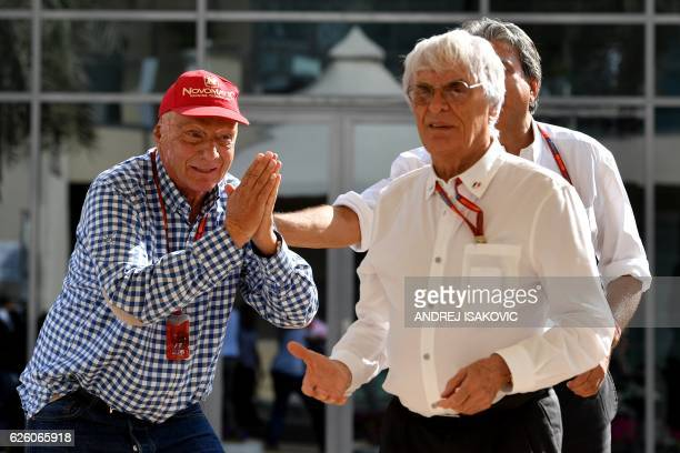 Mercedes nonexecutive chairman and former multiple world champion Niki Lauda and F1 supremo Bernie Ecclestone have fun ahead of the start of the Abu...