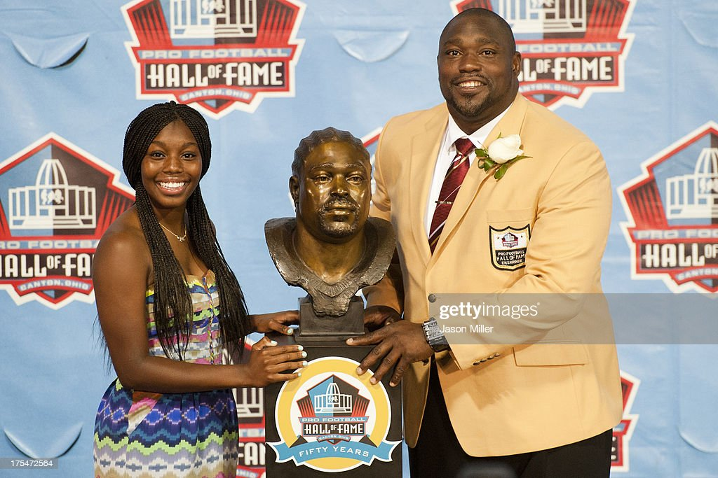 Mercedes Sapp (L) presents her father and former defensive tackle <a gi-track='captionPersonalityLinkClicked' href=/galleries/search?phrase=Warren+Sapp&family=editorial&specificpeople=162706 ng-click='$event.stopPropagation()'>Warren Sapp</a> of the Tampa Bay Buccaneers with his Hall of Fame bust during the NFL Class of 2013 Enshrinement Ceremony at Fawcett Stadium on Aug. 3, 2013 in Canton, Ohio.