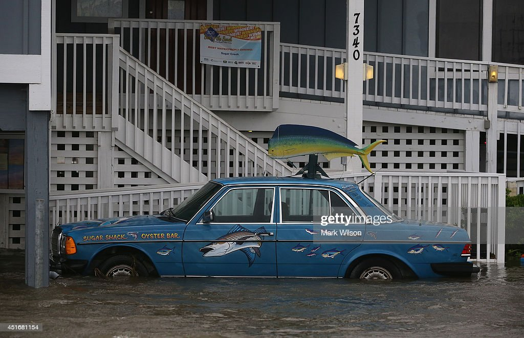 A Mercedes sitting at restaurant on Hwy 64 is flooded by Hurricane Arthur, July 4, 2014 in Nags Head, North Carolina. Hurricane Arthur hit North Carolina's Outer Banks overnight causing wide spead power outages and minimal flooding and damage.