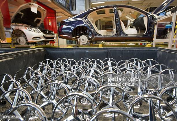 Mercedes stars are arranged in a box before they are mounted to a MercedesBenz SClass car on the assembly line of the Daimler factory in Sindelfingen...