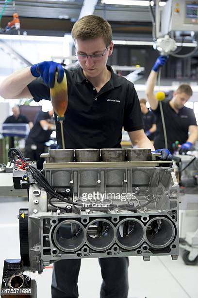 MercedesAMG engine production factory in Affalterbach Germany engineer applies lubricant oil into cylinders for pistons of 63 litre V8 engine