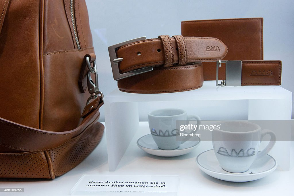 Mercedes-AMG GmbH branded leather apparel and coffee cups sit on display inside the Mercedes-Benz Gallery showroom in Berlin, Germany, on Thursday, Dec. 19, 2013. European new-car sales rose a third consecutive month in November, the longest period of gains in four years. Photographer: Krisztian Bocsi/Bloomberg via Getty Images