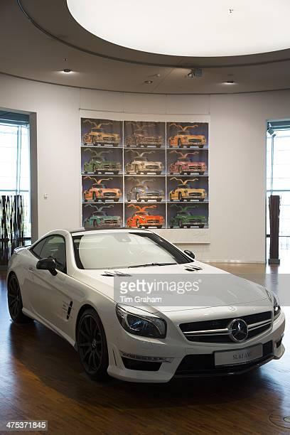 MercedesAMG SL63 AMG V8 biturbo coupe car in Diamond White colour at MercedesAMG showroom in Stuttgart Bavaria Germany