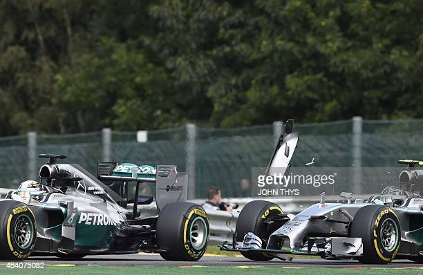 MercedesAMG's British driver Lewis Hamilton and and MercedesAMG's German driver Nico Rosberg collide at the SpaFrancorchamps ciruit in Spa on August...