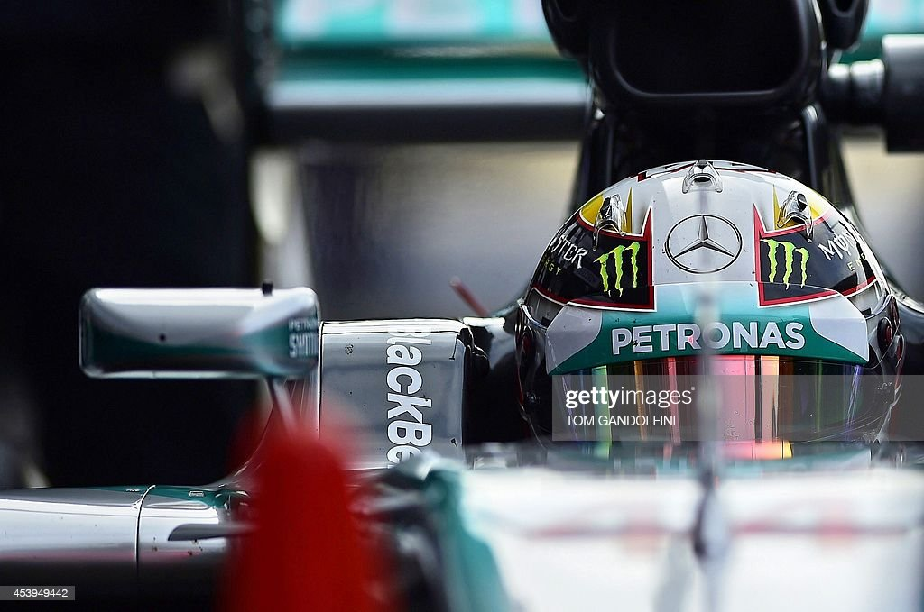 Mercedes-AMG's British driver Lewis Hamilton arrives in the pits during the first practice session at the Spa-Francorchamps circuit in Spa on August 22, 2014 ahead of the Belgium Formula One Grand Prix.