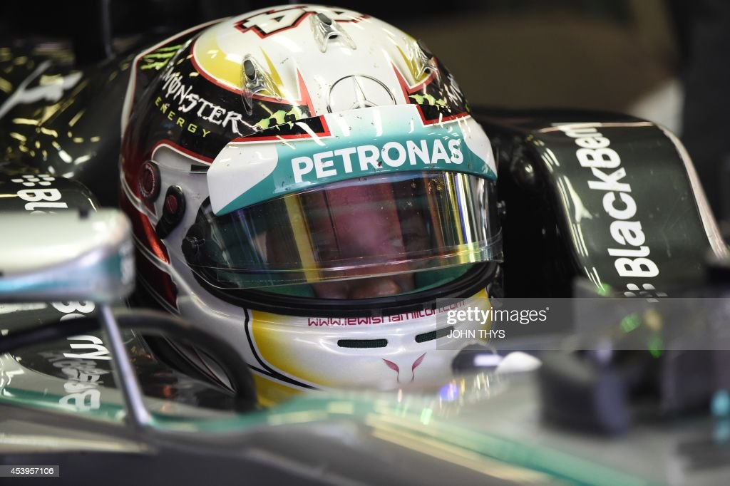 Mercedes-AMG's British driver Lewis Hamilton sits in the pits during the second practice session at the Spa-Francorchamps circuit in Spa on August 22, 2014 ahead of the Belgium Formula One Grand Prix.