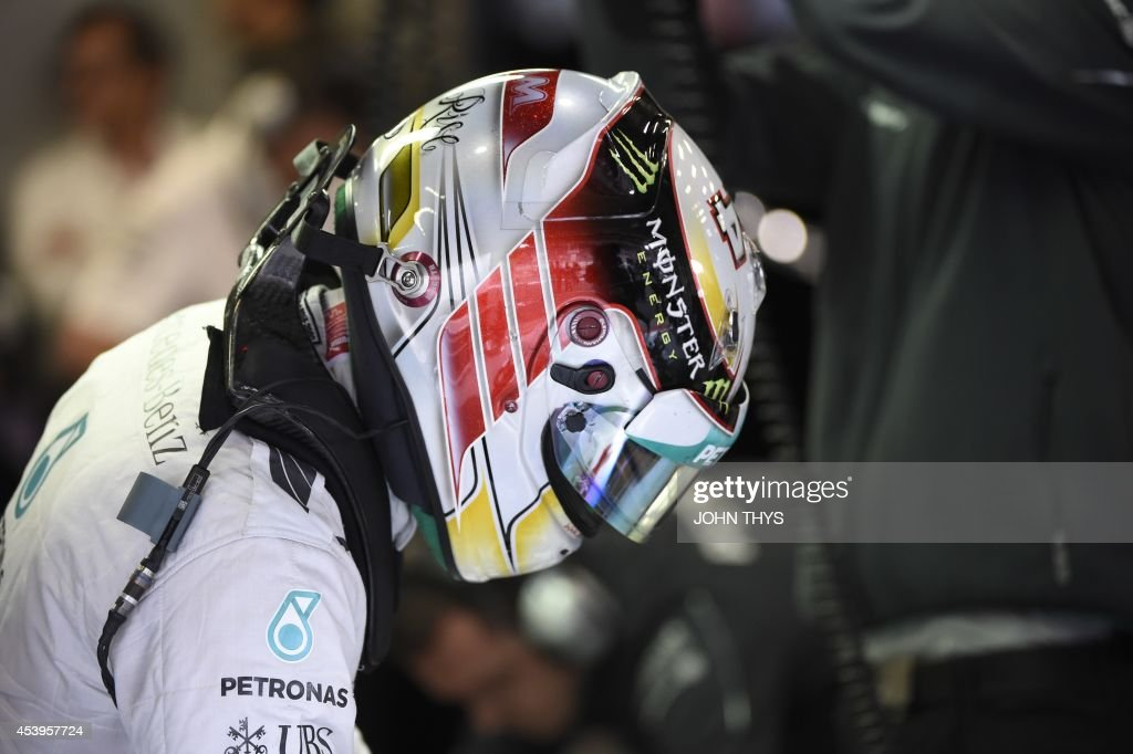 Mercedes-AMG's British driver Lewis Hamilton stands in the pits during the second practice session at the Spa-Francorchamps circuit in Spa on August 22, 2014 ahead of the Belgium Formula One Grand Prix.