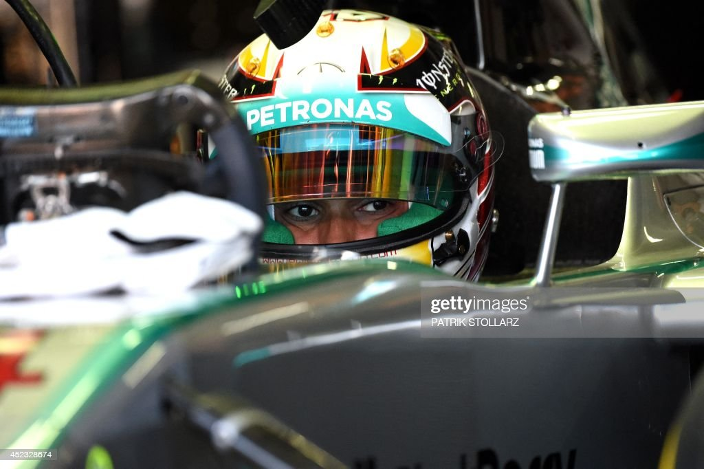 Mercedes-AMG's British driver Lewis Hamilton tests the car during the first practice session ahead of the German Formula One Grand Prix. at the Hockenheimring in Hockenheim, Germany on July 18, 2014.