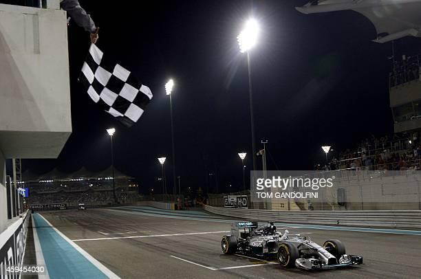 MercedesAMG's British driver Lewis Hamilton wins the Abu Dhabi Formula One Grand Prix at the Yas Marina circuit on November 23 2014 AFP PHOTO / TOM...