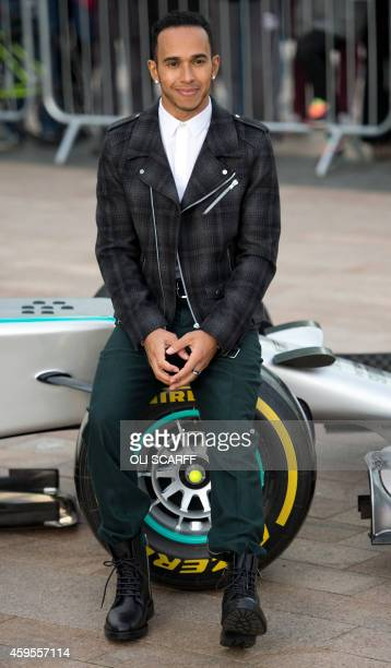MercedesAMG's F1 British driver Lewis Hamilton poses for pictures during a media opportunity in Salford north west England on November 25 2014 The...