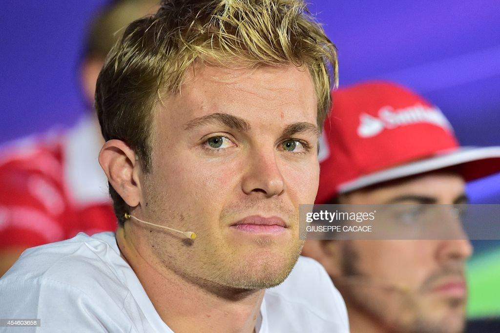 MercedesAMG's German driver Nico Rosberg and Scuderia Ferrari's Spanish driver Fernando Alonso attend a press conference at the Autodromo Nazionale...