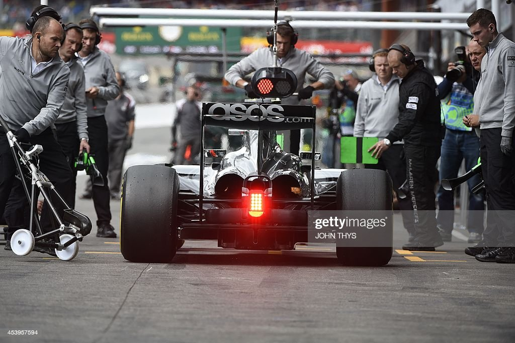Mercedes-AMG's German driver Nico Rosberg arrives in the pits during the second practice session at the Spa-Francorchamps circuit in Spa on August 22, 2014 ahead of the Belgium Formula One Grand Prix.