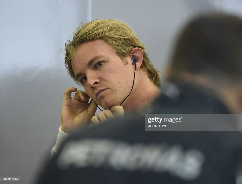 Mercedes-AMG's German driver Nico Rosberg stands in the pits during the second practice session at the Spa-Francorchamps circuit in Spa on August 22, 2014 ahead of the Belgium Formula One Grand Prix.
