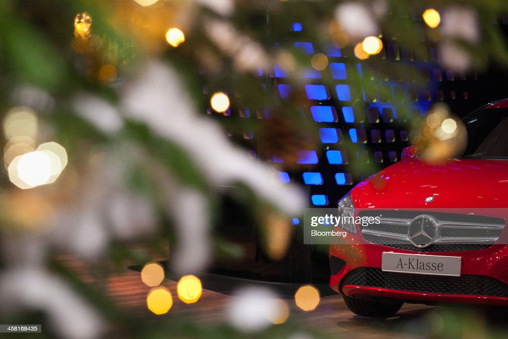 A Mercedes-Benz A180 automobile, produced by Daimler AG, sits on display beside an illuminated Christmas tree in the Mercedes-Benz Gallery showroom in Berlin, Germany, on Thursday, Dec. 19, 2013. European new-car sales rose a third consecutive month in November, the longest period of gains in four years. Photographer: Krisztian Bocsi/Bloomberg via Getty Images