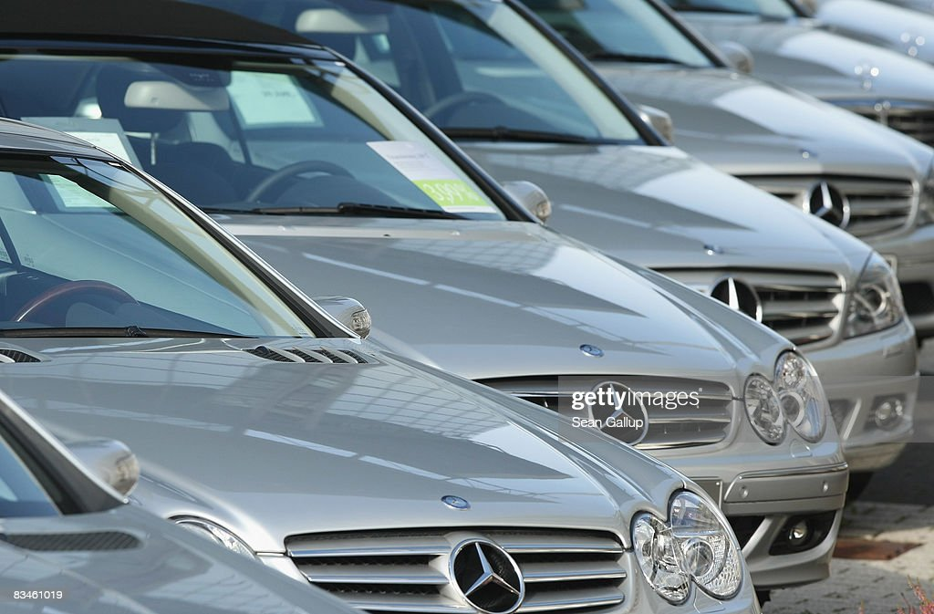 MercedesBenz cars stand at a car dealership on October 28 2008 in Berlin Germany Daimler which owns MercedesBenz has said it will suspend production...