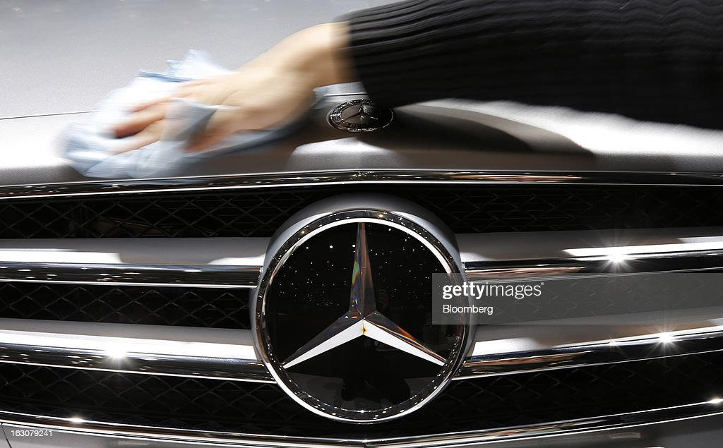 A Mercedes-Benz CLS automobile, produced by Daimler AG, is cleaned by hand ahead of the opening day of the 83rd Geneva International Motor Show in Geneva, Switzerland, on Monday, March 4, 2013. This year's show opens to the public on Mar. 7, and is set to feature more than 100 product premiers from the world's automobile manufacturers. Photographer: Valentin Flauraud/Bloomberg via Getty Images