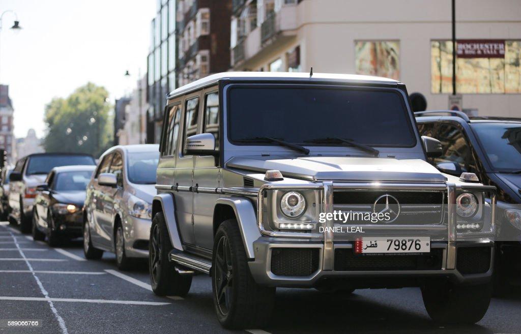 a mercedes benz g class suv luxury car registered in qatar drives through knightsbridge