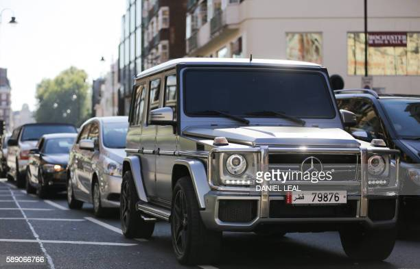 a mercedesbenz gclass suv luxury car registered in qatar drives through knightsbridge in london on august
