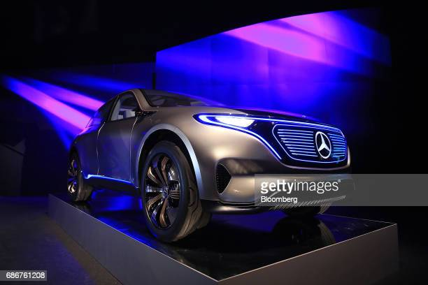 A MercedesBenz Generation EQ electric sportutility vehicle manufactured by Daimler AG stands on display at the Deutsche Accumotive GmbH electric...