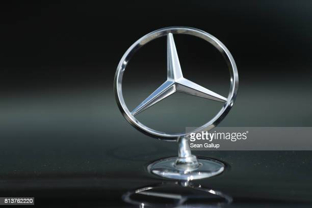 MercedesBenz hood ornament adorns a Mercedes car at a dealership on July 13 2017 in Berlin Germany German media Sueddeutsche Zeitung WDR and NDR are...