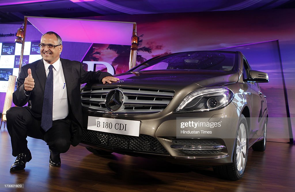 Mercedes-Benz India MD & CEO Eberhard Kerm posing with the newly launched Mercedes-Benz New B-Class 180 CDI luxury Tourer on July 11, 2013 in Mumbai, India. The price of the new B 180 CDI Style (Diesel) is fixed at Rs 22.60 lakh, ex-showroom Mumbai.