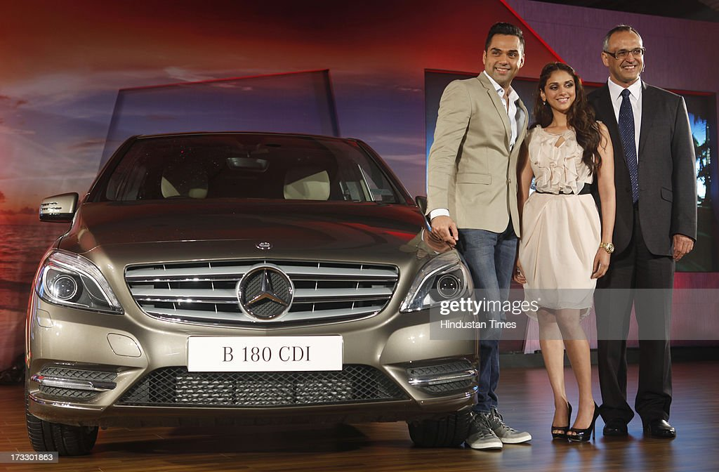 Mercedes-Benz India MD & CEO Eberhard Kerm with Bollywood actors Aditi Rao and Abhay Deol posing with the newly launched Mercedes-Benz New B-Class 180 CDI luxury Tourer on July 11, 2013 in Mumbai, India. The price of the new B 180 CDI Style (Diesel) is fixed at Rs 22.60 lakh, ex-showroom Mumbai.