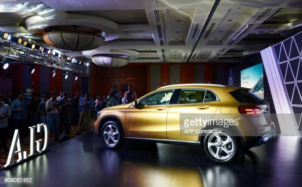 MercedesBenz India's new GLA series car is seen on display during a launch event in Mumbai on July 5 2017 / AFP PHOTO / PUNIT PARANJPE