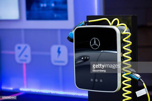 A MercedesBenz logo sits on an electrical charging station during Daimler AG's TecDay Road to the Future event in Stuttgart Germany on Thursday June...
