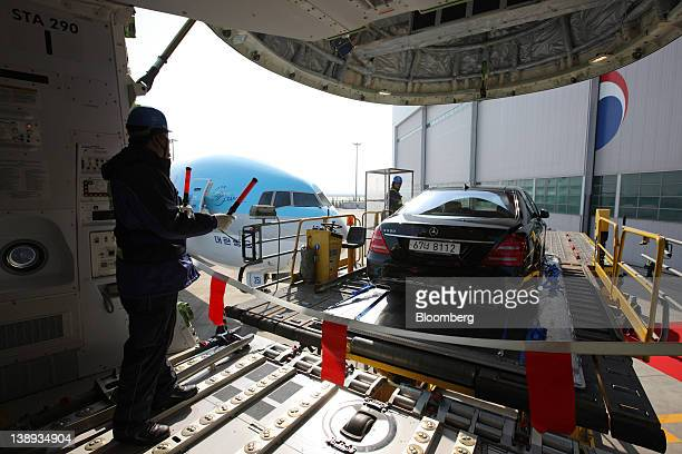 A MercedesBenz SClass S500 automobile is unloaded from a Korean Air Lines Co Boeing Co 7478 freighter during a media preview at Incheon International...