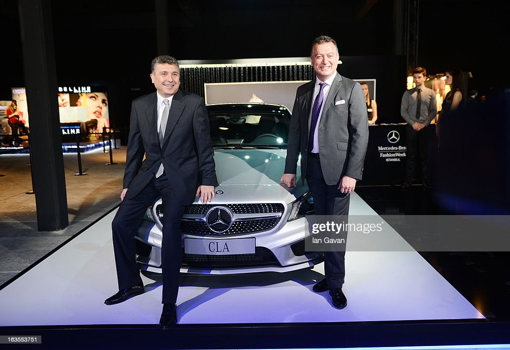 Mercedes-Benz Turk Marketing and Sales Director Suer Sulun (L) and Mercedes-Benz Fashion Week Istanbul Fall/Winter 2013/14 at Antrepo 3 on March 12, 2013 in Istanbul, Turkey.