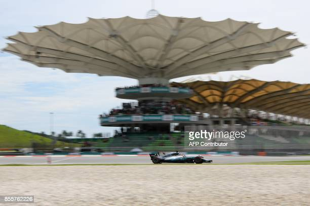 Mercedes's British driver Lewis Hamilton drives his car during the third practice session of the Formula One Malaysia Grand Prix in Sepang on...