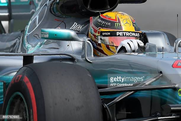 Mercedes's British driver Lewis Hamilton powers his car during the third practice session of the Formula One Malaysia Grand Prix in Sepang on...